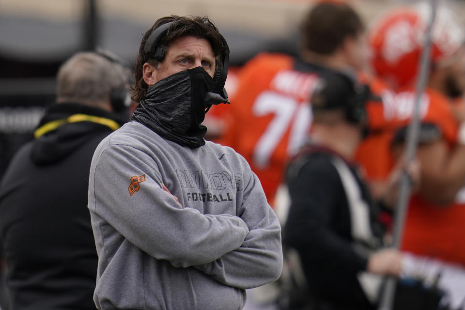 Oklahoma State head coach Mike Gundy looks up at the scoreboard in the first half of an NCAA college football game against Texas Tech in Stillwater, Okla., Saturday, Nov. 28, 2020. (AP Photo/Sue Ogrocki)