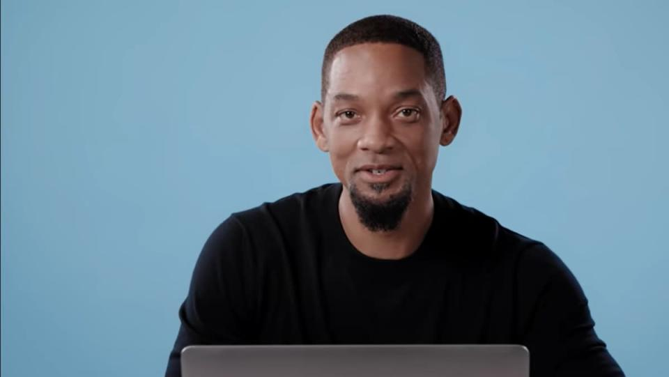 photo of Will Smith in front of laptop computer with a light blue background