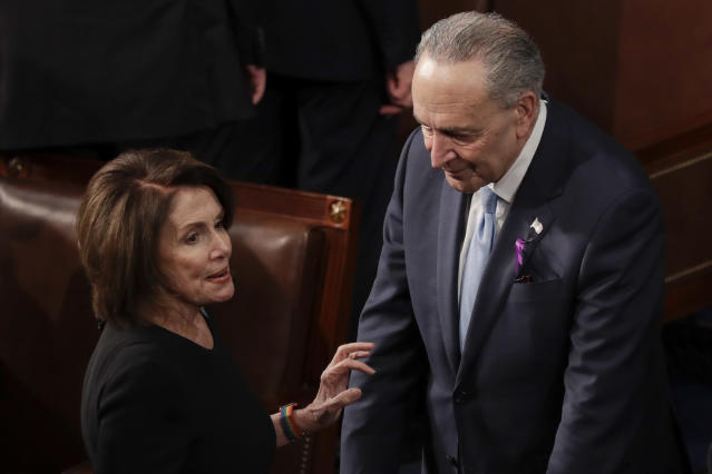 <p>Pelosi of California talks with Schumer of New York before the State of the Union address on Capitol Hill in Washington, D.C., on Jan. 30. (Photo: J. Scott Applewhite/AP) </p>