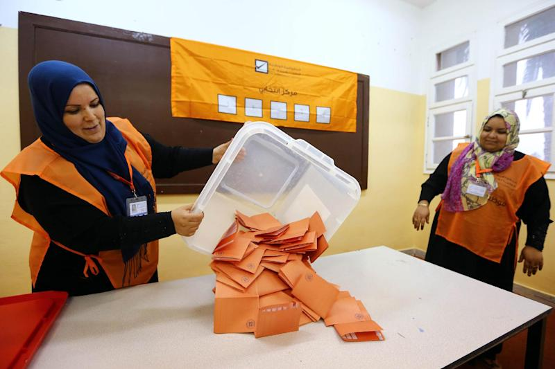 Libyan general election officials count ballots at a polling station in Tripoli's Tajura neighbourhood on June 25, 2014