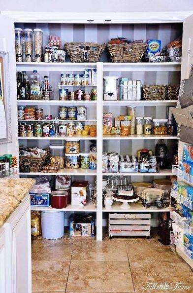 """<p>You don't have to add fancy shelves to make your food storage feel like brand-new. Once shelves are dedicated to serving specific purposes, it'll feel like you did way more than just throw out the food you know you're never going to eat anyway.</p><p><em><a href=""""http://www.tidbitsandtwine.com/my-pantry-makeover-before-after/"""" rel=""""nofollow noopener"""" target=""""_blank"""" data-ylk=""""slk:See more at Tidbits & Twine »"""" class=""""link rapid-noclick-resp"""">See more at Tidbits & Twine »</a></em></p><p><span class=""""redactor-invisible-space""""><strong>What you'll need:</strong> wallpaper, $1 per square foot, <a href=""""https://www.wayfair.com/York-Wallcoverings-Ashford-33-x-20.5-Stripes-Foiled-Wallpaper-Roll-WHW1563.html"""" rel=""""nofollow noopener"""" target=""""_blank"""" data-ylk=""""slk:wayfair.com"""" class=""""link rapid-noclick-resp"""">wayfair.com</a></span><br></p>"""