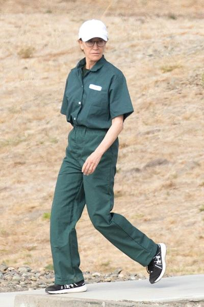 The incarcerated actress was spotted in her prison jumpsuit during a visit from family.
