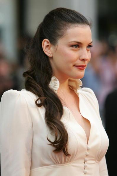 <p>Liv Tyler's trademark long hair is pulled back to showcase her features.</p>