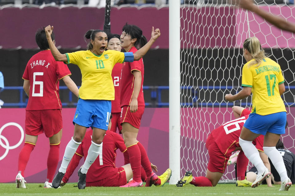 Brazil's Marta (10) celebrates scoring her side's opening goal against China during a women's soccer match at the 2020 Summer Olympics, Wednesday, July 21, 2021, in Rifu, Japan. (AP Photo/Andre Penner)