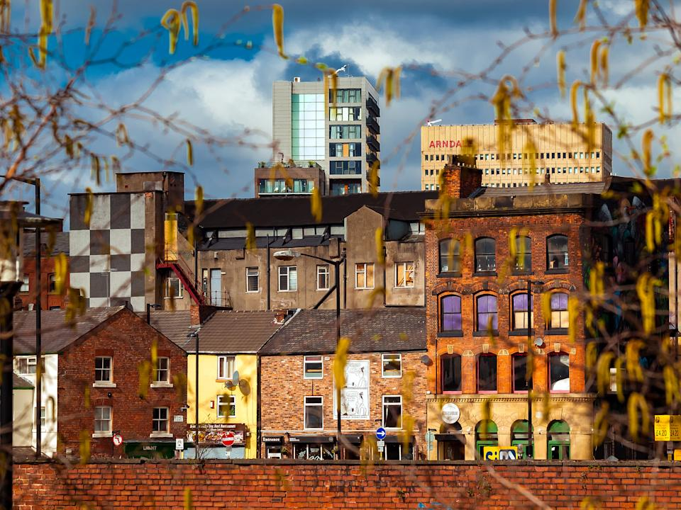 Manchester, England.  A view of the Northern Quarter that it is a trendy neighbourhood in Manchester. It is known due tolo the cool stres and restaurants as well as graffitis decorating some buildings.