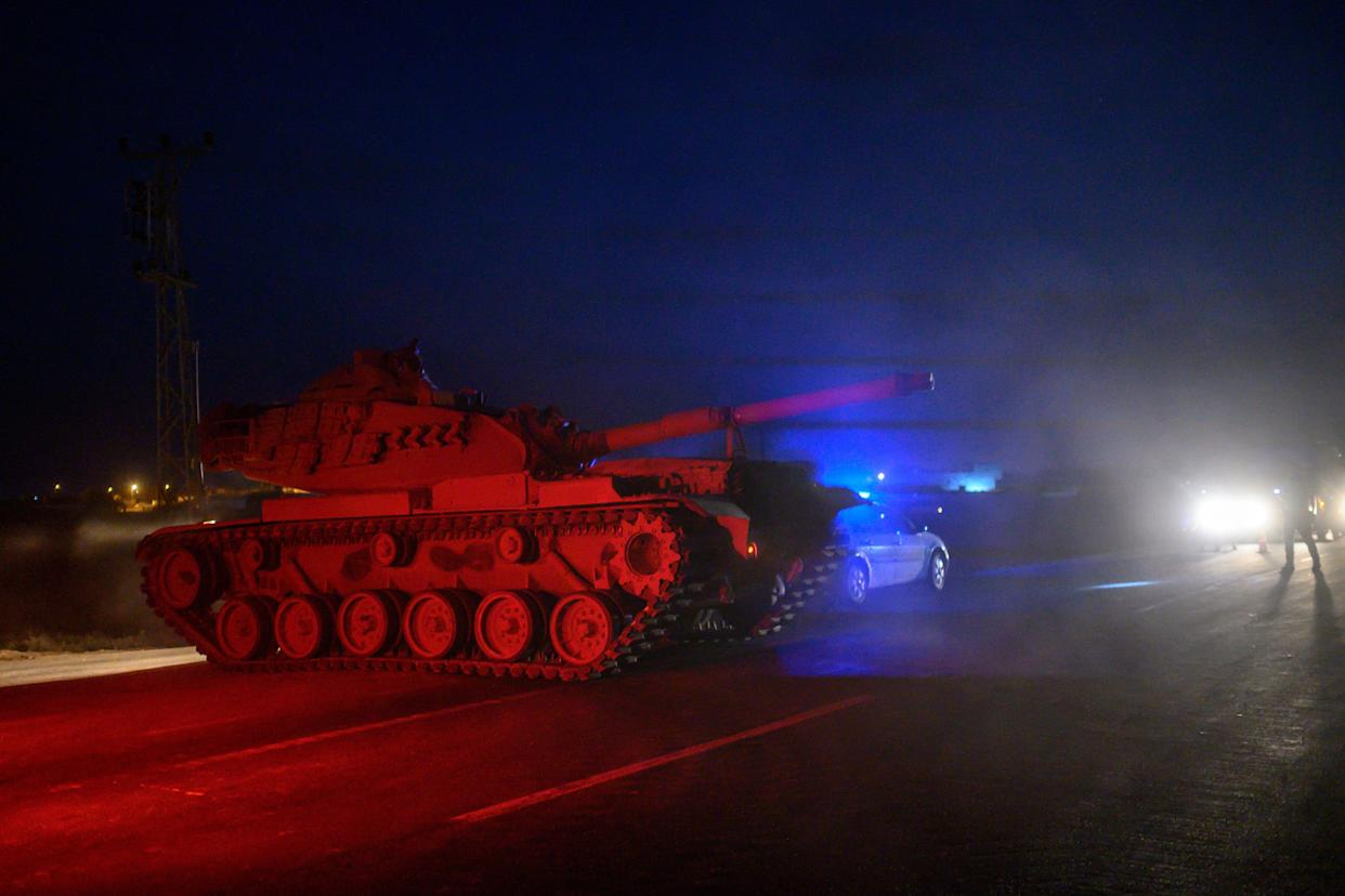 Turkish armed forces drive towards the border with Syria near Akcakale in Sanliurfa province on Oct. 8, 2019. (Photo: Bulent Kilic/AFP via Getty Images)