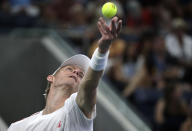 Kevin Anderson, of South Africa, serves to Denis Shapovalov, of Canada, during the third round of the U.S. Open tennis tournament, Friday, Aug. 31, 2018, in New York. (AP Photo/Julio Cortez)
