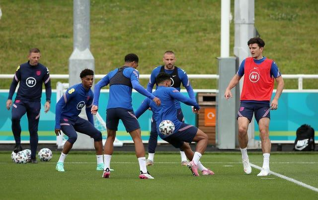 Harry Maguire (right) was among the England players who trained on Monday