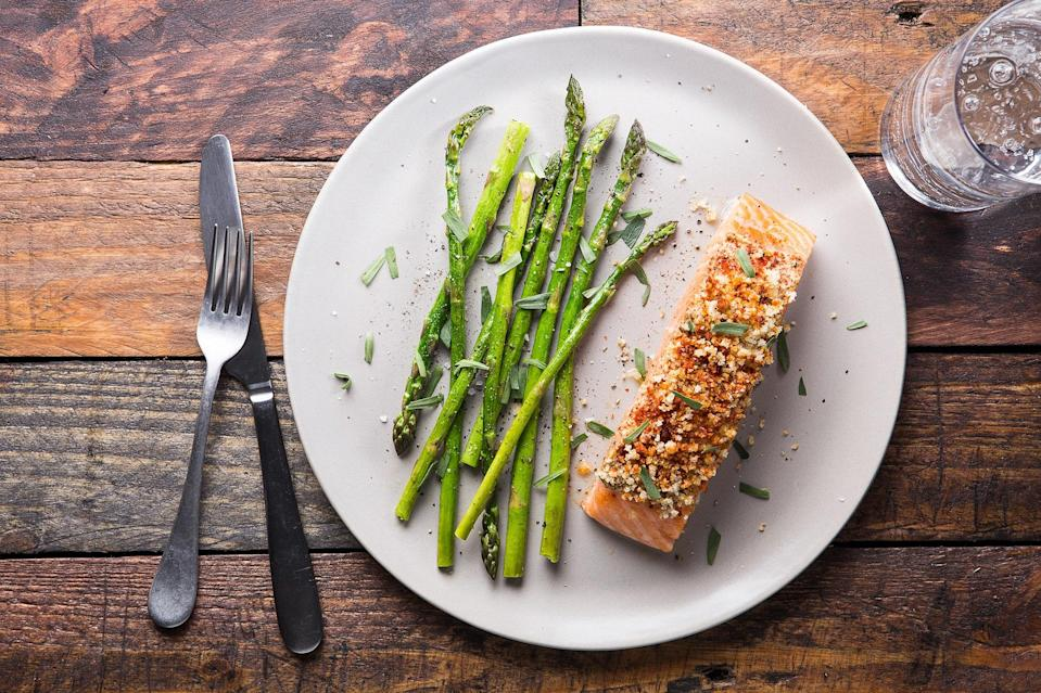 """Gently baking salmon in a low-temperature oven ensures a moist and succulent fillet and only takes about 15 minutes. The asparagus cooks on the same baking sheet, making clean-up a breeze. <a href=""""https://www.epicurious.com/recipes/food/views/baked-mustard-crusted-salmon-with-asparagus-and-tarragon-56389444?mbid=synd_yahoo_rss"""" rel=""""nofollow noopener"""" target=""""_blank"""" data-ylk=""""slk:See recipe."""" class=""""link rapid-noclick-resp"""">See recipe.</a>"""