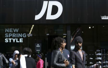 People pass a JD Sports store in London, Britain April 11, 2017. Shares in Britain's JD Sports Fashion Plc climbed to a record high after strong demand for leisure clothing helped to drive a 55 percent rise in headline annual pretax profit, its biggest increase in eight years REUTERS/Neil Hall