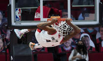 Portland Trail Blazers forward Derrick Jones Jr. dunks against the Miami Heat during the first half of an NBA basketball game in Portland, Ore., Sunday, April 11, 2021. (AP Photo/Craig Mitchelldyer)