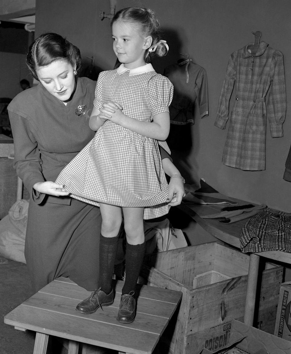 "<p>After the success of <em>Miracle on 34th Street</em><em>,</em> <a href=""https://www.latimes.com/visuals/photography/la-me-fw-archives-child-actress-natalie-wood-in-court-20180102-story.html"" rel=""nofollow noopener"" target=""_blank"" data-ylk=""slk:Wood's contract with 20th Century Fox was updated"" class=""link rapid-noclick-resp"">Wood's contract with 20th Century Fox was updated</a> to $1,000 a week, with the plan that her payments would build for seven years to $3,300 weekly. </p>"