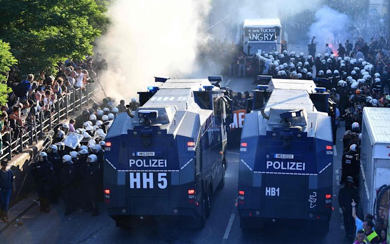 "Riot police move in with water cannon during the ""Welcome to Hell"" rally against the G20 summit in Hamburg - Credit: Getty"
