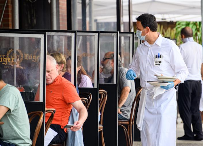 People dine outside Peter Luger Steakhouse in Williamsburg as the city continues Phase 4 of re-opening following restrictions imposed to slow the spread of coronavirus on September 10, 2020 in New York City. (Noam Galai/Getty Images)