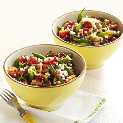 """<p>Kalamata olives and Israeli couscous transform this meal into a Mediterranean-inspired dish. Plus, pinto beans pack this plate with protein.</p><p><a href=""""https://www.goodhousekeeping.com/food-recipes/a8471/tomato-couscous-recipe-ghk0511/"""" rel=""""nofollow noopener"""" target=""""_blank"""" data-ylk=""""slk:Get the recipe for Tomato Couscous »"""" class=""""link rapid-noclick-resp""""><em>Get the recipe for Tomato Couscous »</em></a></p>"""