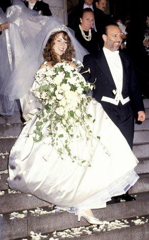 """Mariah Carey's relationship with former Sony Music head Tommy Mottola started as a fairytale. The mogul signed the then-18-year-old starlet to a recording deal in 1988 and helped her achieve stardom by the release of her June 1990 self-titled debut. The two began dating and were wed in a lavish ceremony at New York's St. Thomas Episcopal Church on June 5, 1993. However, by 1997, Carey filed for divorce, claiming that Mottola, 20 years her senior, was too controlling. """"It felt like suddenly I had a strict father,"""" she told Interview magazine in 2007. """"With Tommy it felt like I had this controlling situation where I wasn't allowed to be myself."""" However, after their divorce was finalized in February 1998, tension between the two ensued. Mottola has been accused of sabotaging Carey's career, prompting her 2001 breakdown. (See more in Jennifer Lopez entry.) Mottola will reportedly discuss his marriage to Carey in his book, Hitmaker: The Man And His Music, due out in January 2013. (photo: Ron Galella, WireImage)"""