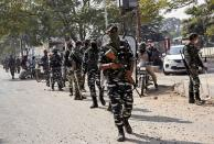 Paramilitary soldiers patrol an area as votes are being counted for the Bihar state assembly polls, in Patna, India, Tuesday, Nov. 10, 2020. (AP Photo/Aftab Alam Siddiqui)