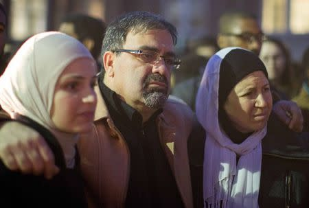 Namee Barakat with his wife Layla (R) and daughter Suzanne, family of shooting victim Deah Shaddy Barakat, attend a vigil on the campus of the University of North Carolina in Chapel Hill, North Carolina February 11, 2015.  REUTERS/Chris Keane
