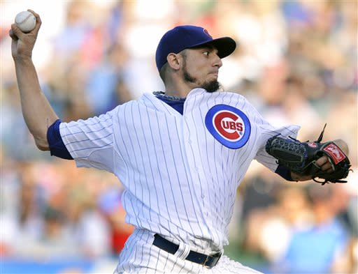 Chicago Cubs starter Matt Garza delivers a pitch during the first inning of a baseball game against the St. Louis Cardinals in Chicago, Saturday, July 13, 2013. (AP Photo/Paul Beaty)