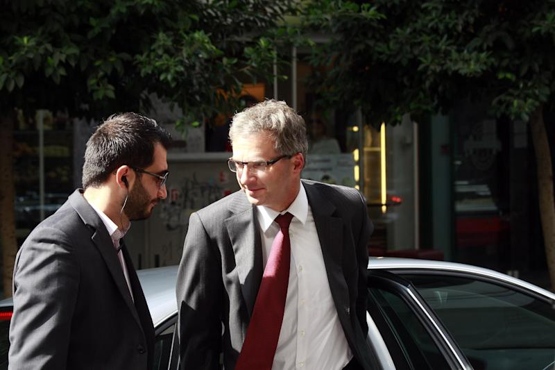 Klaus Masuch of the European Central Bank, right, arrives at the finance ministry for a meeting with Finance Minister Yannis Stournaras, unseen, in Athens, Greece, on Sunday, Sept. 22, 2013. Greece has resumed talks with the so-called troika of creditors _ the European commission, the European Central Bank and the International Monetary Fund _ to review progress in stabilizing the indebted country's finances. (AP Photo/Kostas Tsironis)