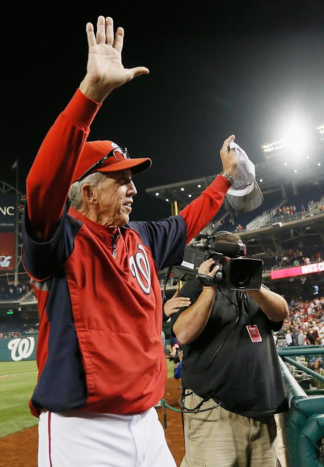 WASHINGTON, DC - SEPTEMBER 20: Manager Davey Johnson of the Washington Nationals waves to the crowd after the Nationals beat the Los Angeles Dodgers 4-1 to clinch a playoff spot at Nationals Park on September 20, 2012 in Washington, DC. (Photo by Rob Carr/Getty Images)