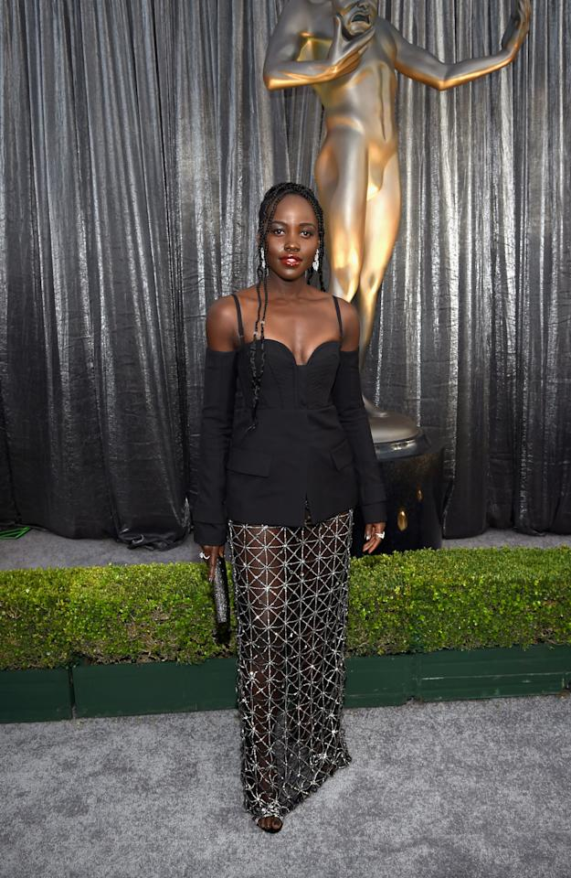 <p>Wearing a black Vera Wang dress, Lupita Nyong'o dazzled in Messika jewelry on the silver carpet. The <em>Black Panther</em> star has become a fixture during awards seasons and rarely disappoints. (Photo: Getty Images) </p>