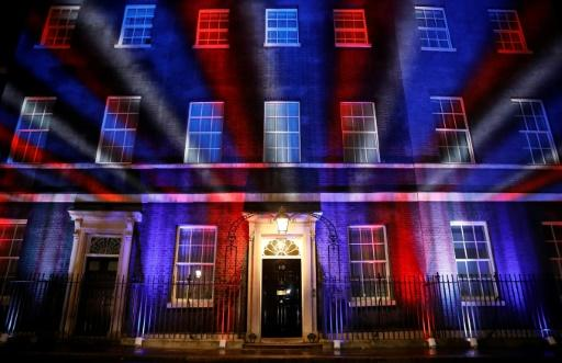 Red, white and blue lights illuminate 10 Downing Street, the official residence of Britain's Prime Minister, in central London after Britain left the European Union
