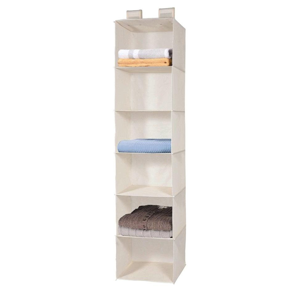"""<p>Light, foldable, and spacious, the <a href=""""https://www.popsugar.com/buy/MaidMax%206-Tier%20Cloth%20Hanging%20Shelf-465772?p_name=MaidMax%206-Tier%20Cloth%20Hanging%20Shelf&retailer=amazon.com&price=13&evar1=casa%3Auk&evar9=46355519&evar98=https%3A%2F%2Fwww.popsugar.com%2Fhome%2Fphoto-gallery%2F46355519%2Fimage%2F46355643%2FMaidMax-6-Tier-Cloth-Hanging-Shelf&list1=college%2Corganization%2Cclosets%2Csmall%20spaces%2Ccloset%20organization%2Csmall%20space%20living%2Cdorms&prop13=api&pdata=1"""" rel=""""nofollow noopener"""" target=""""_blank"""" data-ylk=""""slk:MaidMax 6-Tier Cloth Hanging Shelf"""" class=""""link rapid-noclick-resp"""">MaidMax 6-Tier Cloth Hanging Shelf</a> ($13) is the perfect way to maximize the vertical space available in your closet, no matter how small that closet may be.</p>"""