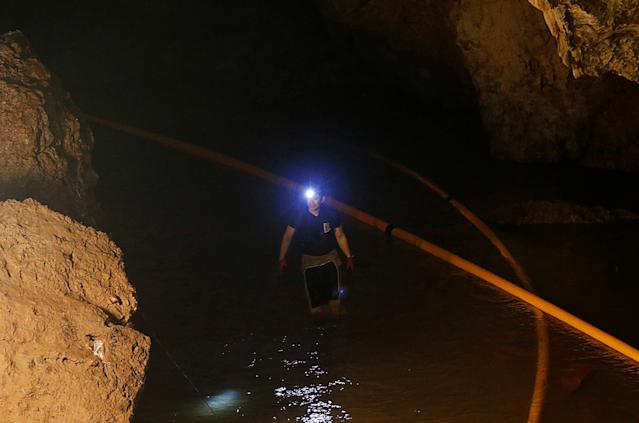 <p>A diver walks in the Tham Luang cave complex during the search for members of an under-16 soccer team and their coach in Chiang Rai, Thailand, on July 1, 2018. (Photo: Soe Zeya Tun/Reuters) </p>