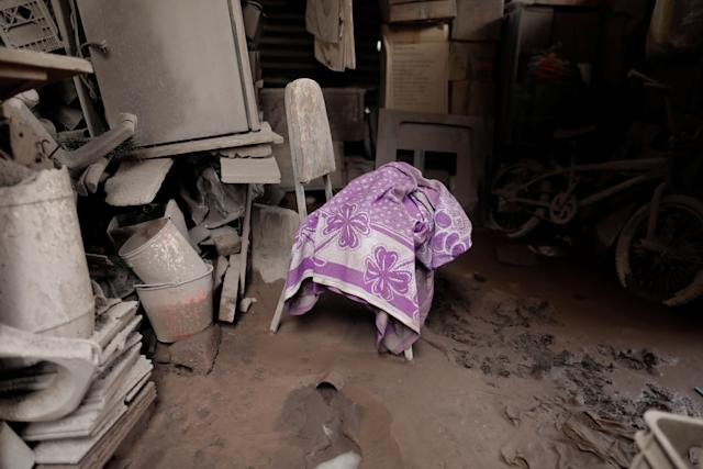 <p>A blanket lies on a chair inside a house affected by the eruption of the Fuego volcano at San Miguel Los Lotes in Escuintla, Guatemala, June 10, 2018. (Photo: Carlos Jasso/Reuters) </p>