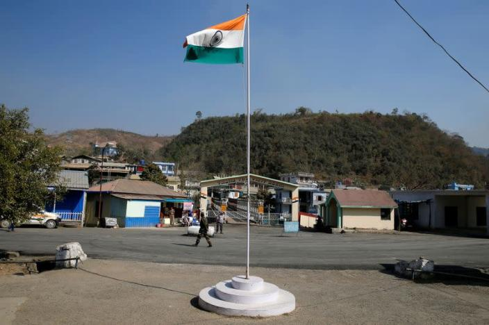 FILE PHOTO: An Indian national flag flies next to an immigration check post on the India-Myanmar border in Zokhawthar village