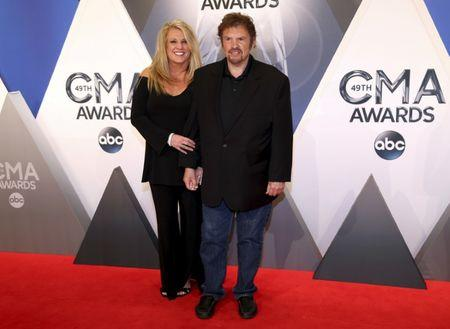 Jeff Cook and his wife Lisa arrive at the 49th Annual Country Music Association Awards in Nashville