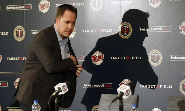 Minnesota Twins chief baseball officer Derek Falvey reaches for his notes before a a news conference Tuesday, Oct.2, 2018 in Minneapolis where he announced that Minnesota Twins manager Paul Molitor was fired, one season after he won the American League Manager of the Year award. In four seasons under Molitor, the Twins went 305-343 with one appearance in the playoffs in 2017. They were 78-84 this year, long out of postseason contention after a series of early setbacks to several key players. Listening at left is general manager Thad Levine. (AP Photo/Jim Mone)