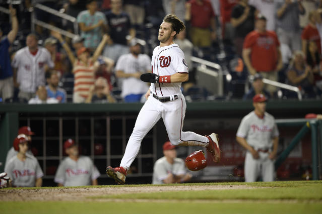Washington Nationals' Bryce Harper runs towards home to score on a single by Daniel Murphy during the eighth inning of a baseball game against the Philadelphia Phillies, early Monday, June 25, 2018, in Washington. The Nationals won 8-6. (AP Photo/Nick Wass)