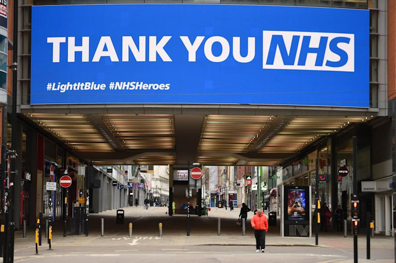 An information board displays a message thanking the NHS in a near-empty street in Manchester on April 4, 2020, as life in Britain continues during the nationwide lockdown to combat the novel coronavirus pandemic. (Photo by Oli SCARFF / AFP) (Photo by OLI SCARFF/AFP via Getty Images)