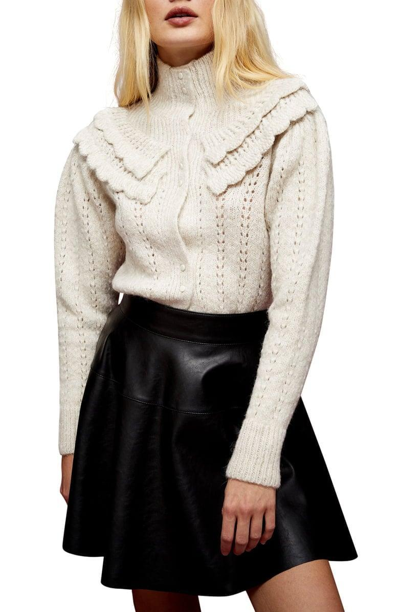 <p>Tap into the statement collar trend with this <span>Topshop High Neck Cardigan</span> ($68).</p>