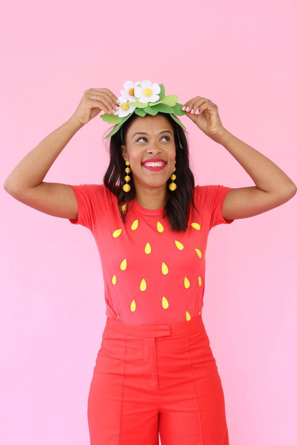 """<p>Amber Kemp-Gerstel put together this sweet strawberry look with paper and iron-on vinyl.</p><p><strong>Get the full tutorial at <a href=""""https://damasklove.com/diy-strawberry-halloween-costume/"""" rel=""""nofollow noopener"""" target=""""_blank"""" data-ylk=""""slk:Damask Love"""" class=""""link rapid-noclick-resp"""">Damask Love</a>.</strong></p><p><strong><a class=""""link rapid-noclick-resp"""" href=""""https://www.amazon.com/Hanes-Womens-Nano-T-Shirt-Large/dp/B00KRYMB88/ref=sr_1_4?tag=syn-yahoo-20&ascsubtag=%5Bartid%7C10050.g.4571%5Bsrc%7Cyahoo-us"""" rel=""""nofollow noopener"""" target=""""_blank"""" data-ylk=""""slk:Shop Red T-Shirts"""">Shop Red T-Shirts</a><br></strong></p>"""