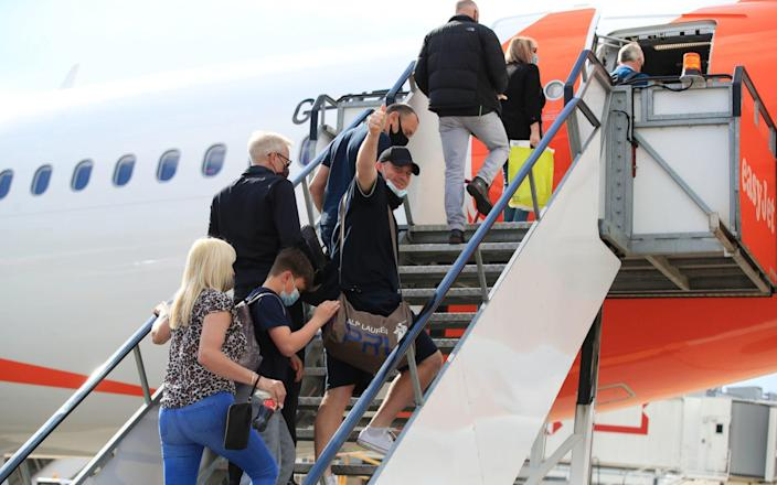 Passengers prepare to board an easyJet flight to Faro, Portugal on May 17 - Gareth Fuller/PA Wire
