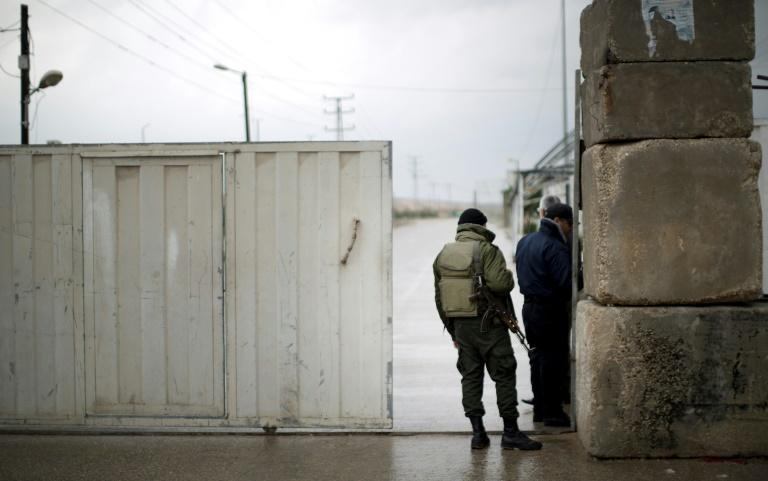 Palestinian Hamas security forces stand at the Palestinian side of the Erez pedestrian crossing with Israel after it was closed on March 13, 2014