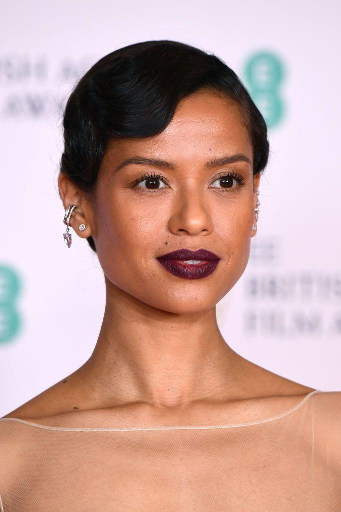 """<p>Gugu Mbatha-Raw's modern take on 1920s glamour was created by make-up artist <a href=""""https://www.instagram.com/babskymakeup/"""" rel=""""nofollow noopener"""" target=""""_blank"""" data-ylk=""""slk:Alex Babsky"""" class=""""link rapid-noclick-resp"""">Alex Babsky</a>, who kept the eyes neutral to ensure all focus was on that perfect berry lip. </p>"""