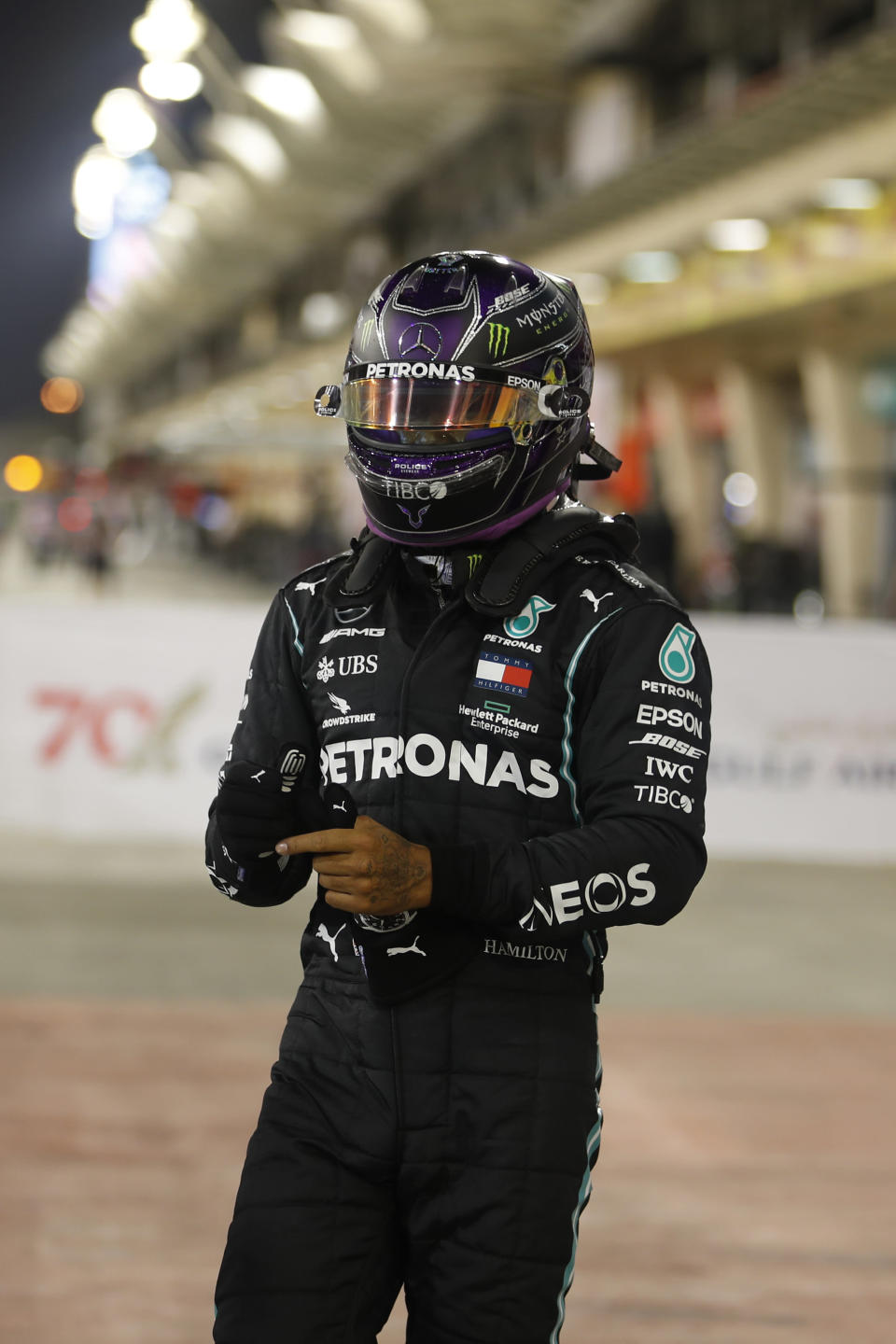 Mercedes driver Lewis Hamilton of Britain, right, celebrates after winning the pole position after the qualifying session at the Formula One Bahrain International Circuit in Sakhir, Bahrain, Saturday, Nov. 28, 2020. (Hamad Mohammed, Pool via AP)