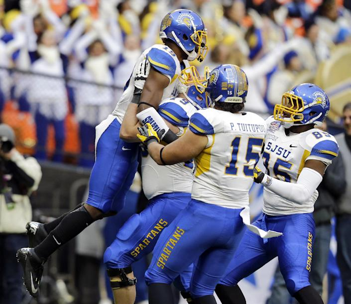 San Jose State wide receiver Kyle Nunn (19) is picked up by offensive tackle Jon Meyer (79), tight end Peter Tuitupou (15) and tight end Keenan Brown (85) after his touchdown catch during the first half of the Military Bowl NCAA college football game against Bowling Green at RFK Stadium, Thursday, Dec. 27, 2012, in Washington. (AP Photo/Alex Brandon)