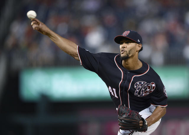 Washington Nationals starting pitcher Joe Ross delivers a pitch during the first inning of the team's baseball game against the New York Mets, Friday, Sept. 21, 2018, in Washington. (AP Photo/Nick Wass)