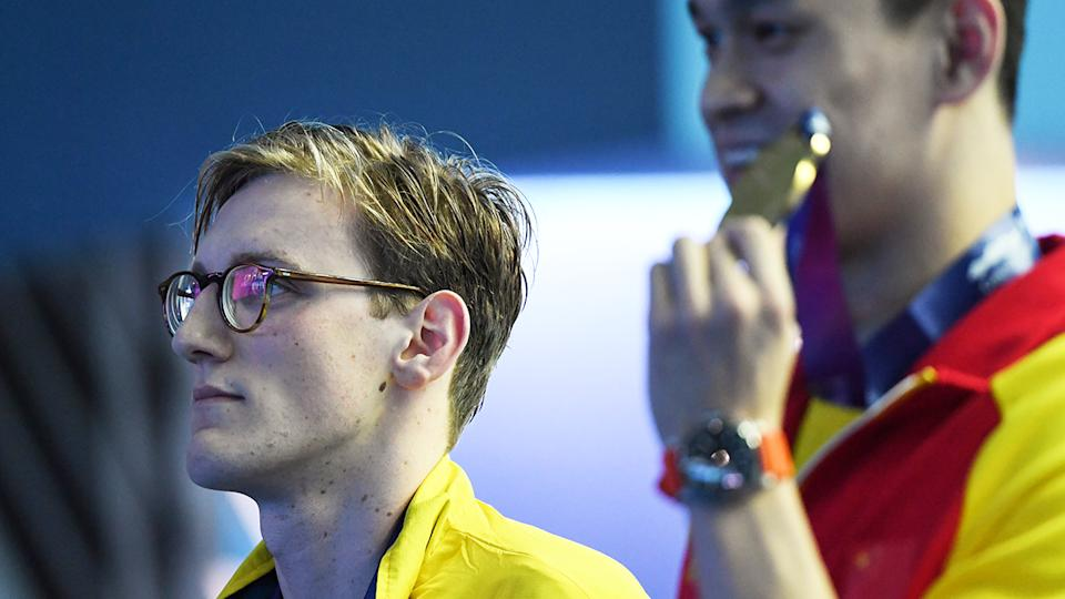 Mack Horton looks on as Sun Yang is awarded gold at the 2016 World Championships in South Korea.