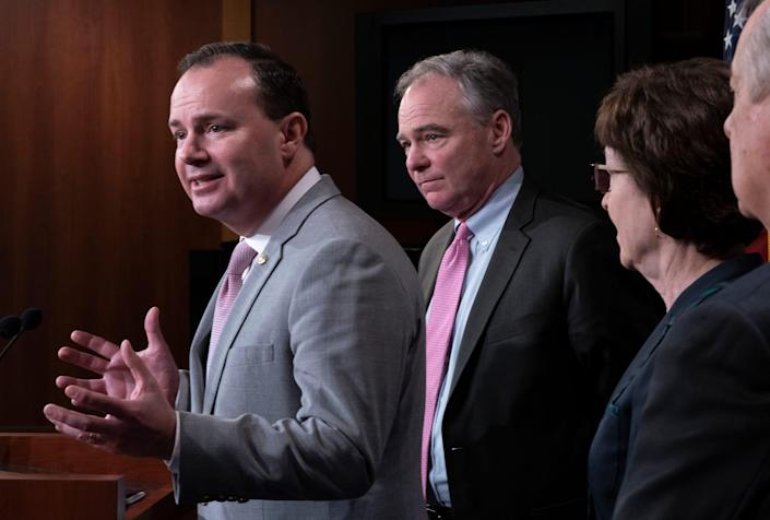 Sens. Mike Lee of Utah, left, and Susan Collins of Maine were among the Republicans who supported Sen. Tim Kaine, D-Va., who sponsored a resolution asserting that President Donald Trump must seek approval from Congress before engaging in military action against Iran.