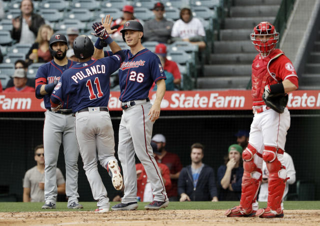 Minnesota Twins' Jorge Polanco (11) celebrates his two-run home run with teammate Max Kepler (26) during the second inning of a baseball game against the Los Angeles Angels Thursday, May 23, 2019, in Anaheim, Calif. (AP Photo/Marcio Jose Sanchez)