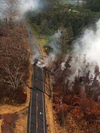Aerial view of ground cracks on a road during an overflight of the eruptrive fissure area following eruption of Kilauea volcano, Hawaii May 17, 2018. United States Geological Survey (USGS)/Handout via REUTERS