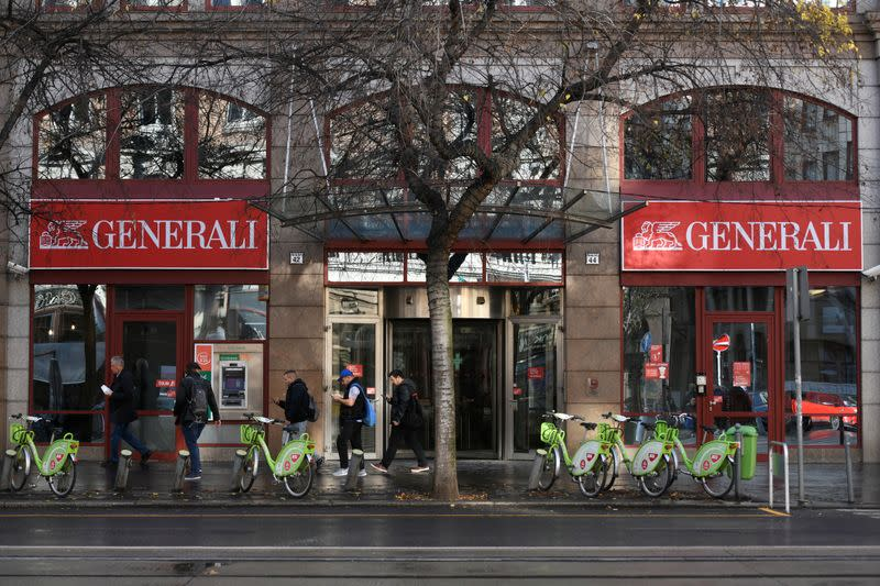 People walk past the headquarters of insurance company Generali in Budapest