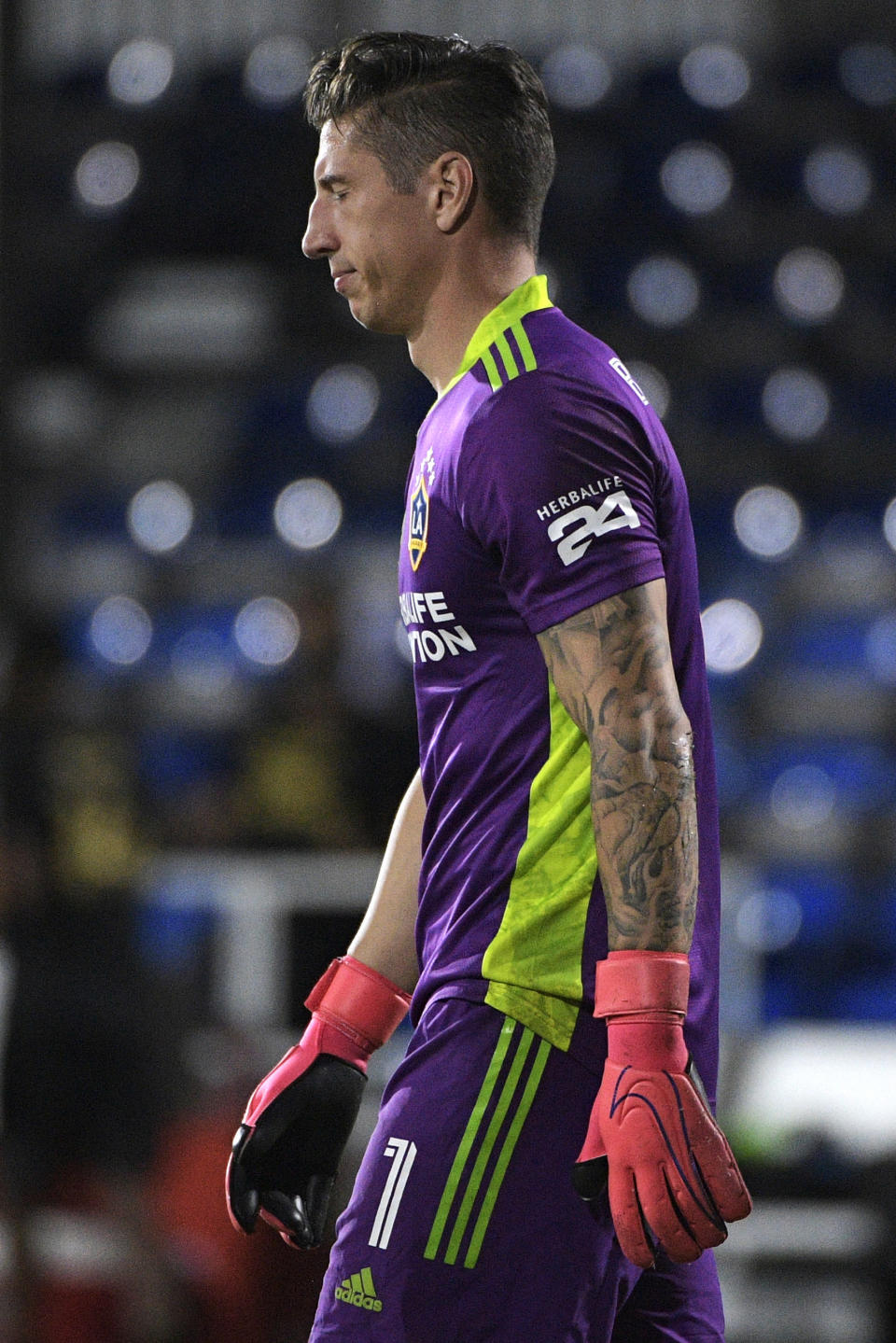 LA Galaxy goalkeeper David Bingham (1) reacts after giving up a goal to Los Angeles FC forward Diego Rossi during the second half of an MLS soccer match, early Sunday, July 19, 2020, in Kissimmee, Fla. (AP Photo/Phelan M. Ebenhack)