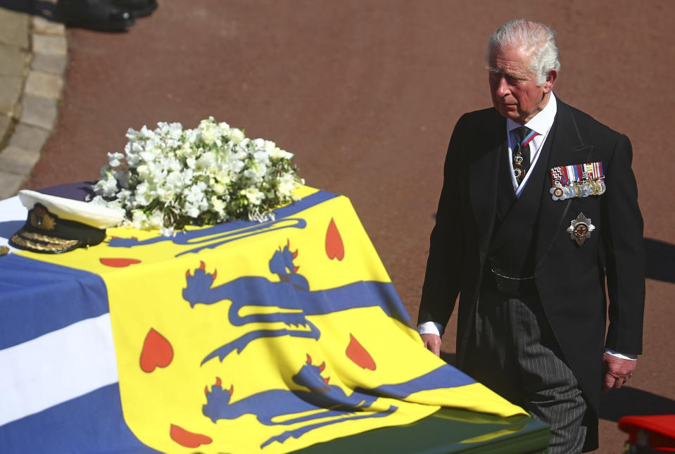 Prince Charles follows the coffin of his father Britain's Prince Philip during the funeral inside Windsor Castle in Windsor, England, Saturday, April 17, 2021. Prince Philip died April 9 at the age of 99 after 73 years of marriage to Britain's Queen Elizabeth II. (Hannah McKay/Pool via AP)